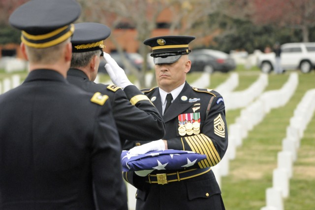 Command Sgt. Maj. William Wilder, 1st battalion, 3rd U.S. Infantry Regiment (The Old Guard), hands off the American Flag that draped the casket of Frank Woodruff Buckles, the last surviving American World War I veteran, to Vice Chief of Staff Gen. Peter Chiarelli. Gen. Chiarelli later presented the flag to Susannah Flanagan, Buckles' daughter.