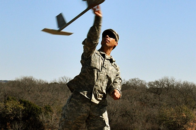 Sgt. John Martinez, tanker with Company D, 1st Battalion, 5th Cavalry Regiment, 2nd Brigade Combat Team, launches the Raven RQ-11B unmanned aerial vehicle in the air during the 41st Fires Bde. and the 2nd BCT re-certification training at the House Creek Assault Course, Fort Hood, Texas, March 10-11. The Raven can fly up to 60 miles an hour.