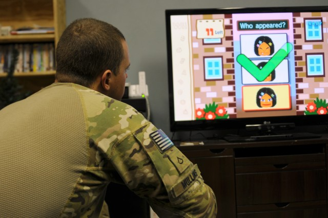 "KHOWST PROVINCE, Afganistan - U.S. Army Pfc. Jeremiah Mullins, a military policeman from Richmond, Va., attached to 1st Battalion, 26th Infantry Regiment, 3rd Brigade Combat Team, 1st Infantry Division, Task Force Duke, plays ""Brain Academy"" on the Nintendo Wii at the TF Duke mild traumatic brain injury reconditioning center on Forward Operating Base Salerno, Afghanistan, March 16. The video game has been adopted by several mTBI centers across Afghanistan to help patients' visual, perceptual, balance and cognitive rehabilitation. (U.S. Army photo by Staff Sgt. Ben K. Navratil)"