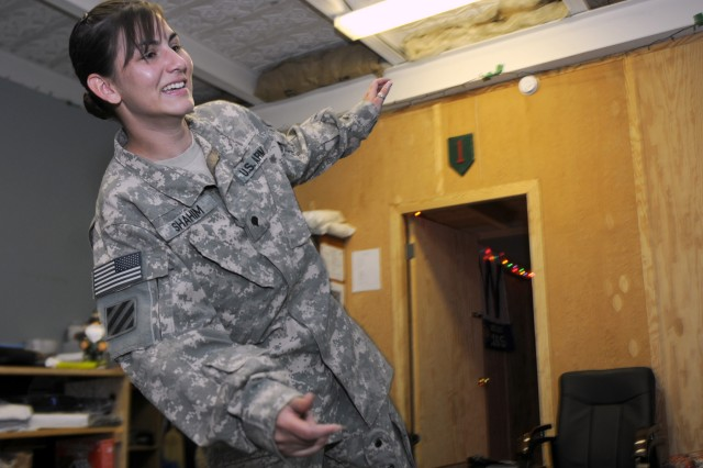 """KHOWST PROVINCE, Afghanistan - U.S. Army Spc. Chamai Shahim, a CH-47 Chinook mechanic from Portland, Ore., currently attached to the 1st Battalion, 168th Infantry Regiment, 3rd Brigade Combat Team, 1st Infantry Division, Task Force Duke, plays """"Wii Fit"""" on the Nintendo Wii gaming system at the TF Duke mild traumatic brain injury reconditioning center at Forward Operating Base Salerno, Afghanistan, March 16. The video game is used to test Soldiers' balance and perception, and monitor they're recovery progress after they've been diagnosed with mTBI. (U.S. Army photo by Staff Sgt. Ben K. Navratil)"""
