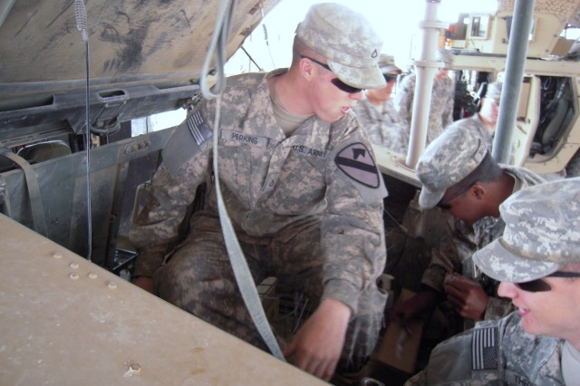 BAGHDAD - Troopers of 6th Squadron, 9th Cavalry Regiment, attached to 2nd Advise and Assist Brigade, 1st Infantry Division, United States Division - Central perform preventive maintenance checks and services on March 8.