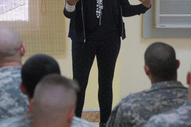 "CONTINGENCY OPERATING SITE MAREZ, Iraq - Carmen Barton, an entertainer from St. Louis, performs a stand-up comedy routine for Soldiers assigned to Troop B, 1st Squadron, 9th Cavalry Regiment, 4th Advise and Assist Brigade, 1st Cavalry Division, during the ""It's Not That Time of the Month"" All Female Comedy tour at Al Kisik, March 12, 2011. U.S. Soldiers conduct Tadreeb al Shamil, Arabic for All Inclusive Training with the 3rd Division Iraqi Army to enhance Iraqis soldiers' offensive and defensive capabilities at the small unit and battalion level. The comedy performance was the first Morale, Welfare and Recreation event hosted for U.S. Soldiers serving at the remote operating base."