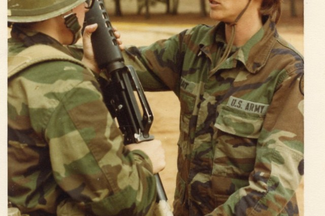 This undated photo shows Galen Grant instructing a Soldier in Basic Combat Training about 30 years ago. Grant served two tours of duty as a drill sergeant on Fort Jackson.