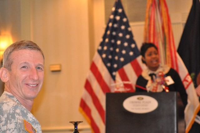 Family Support spokesperson, LaVondra T. Scarver asks questions of the audience as LTC Bromberg looks out for the reply, during the 2011 FORSCOM Army Family Action Plan Conference (AFAP).