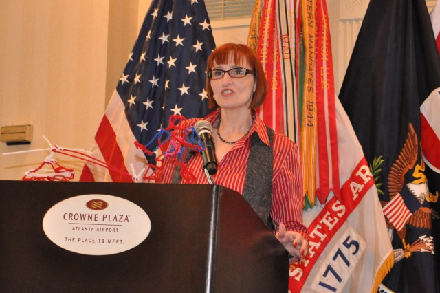 Christian P. Geye , Force Support spokesperson presents her issues to those in attendance at the FORSCOM Army Family Action Plan (AFAP) Conference on March 12, 2011.