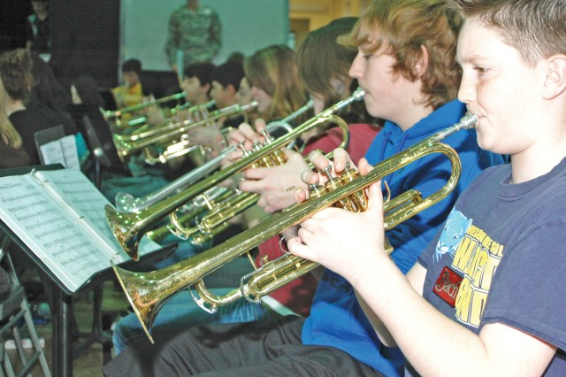 Thirty-one middle school trumpte players rehears as part of the Heidelberg School District's Middle School Honor Band March 9 at Wiesbaden Middle School.
