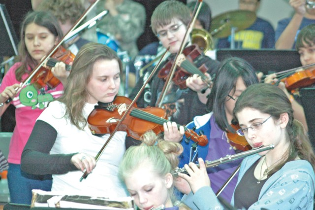 The Middle School Honor Band included eight students playing violins and three playing violas.