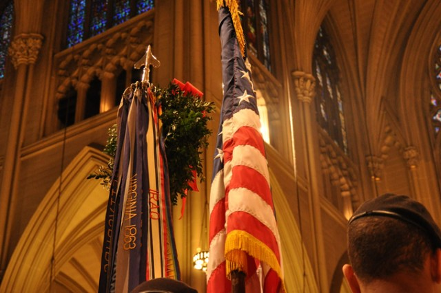 """The colors of the New York Army National Guard's 1st Battalion, 69th Infantry Regiment, the famous """"Fighting 69th"""" open the mass at St. Patrick's Cathedral in New York City.  The battalion, famous for its role in the Civil War as part of the Irish Brigade, has led the New York City St. Patrick's Day parade for the past 160 years."""