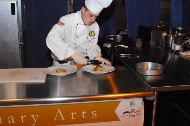 Spc Jonathan Apolito, 75th Fires Brigade, plates his entree for the judges while competing for the Junior Chef of the year at the 36th annual Culinary Arts Competition in Fort Lee.  Photo courtesy of Staff Sgt. Sallette