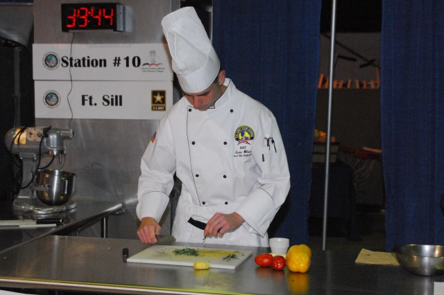 Sgt. Isaac Wilson, 75th Fires Brigade, prepares his spices during the Nutritional Hot Food competition at the 36th annual Culinary Arts Competition in Fort Lee.  Photo courtesy of Staff Sgt. William Sallette