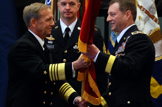 JOINT BASE ELMENDORF-RICHARDSON -- Commander of U. S. Special Operations Command, MacDill Air Force Base, Fla., Admiral Eric T. Olson, passes the two-star flag to newly promoted Maj. Gen. Raymond Palumbo, U.S. Army Alaska commander, in a March 18 promotion ceremony here.