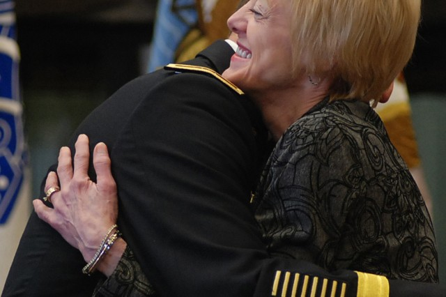 JOINT BASE ELMENDORF-RICHARDSON, Alaska -- Alice Palumbo gives a congratulatory hug to her husband, newly promoted Maj. Gen. Raymond Palumbo, U.S. Army Alaska commander, after the general's March 18 promotion ceremony here.