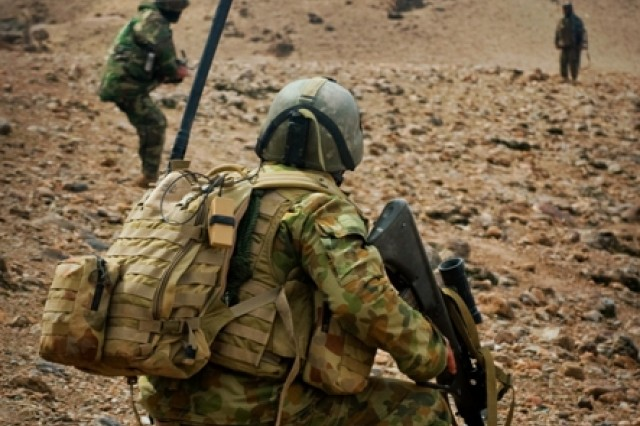 Afghan National Army soldiers lead a patrol up a hill Mar. 2 in Mirabad Valley, Afghanistan, as an Australian Army soldier looks on. (U.S. Army photo by Spc. Edward A. Garibay, 16th Mobile Public Affairs Detachment)