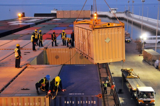 Connex's containing various class of supply for U.S. Forces in the Southwest Asia region aboard the MV Virginian, are being unloaded at the Kuwait Naval Base on March 19, 2011.