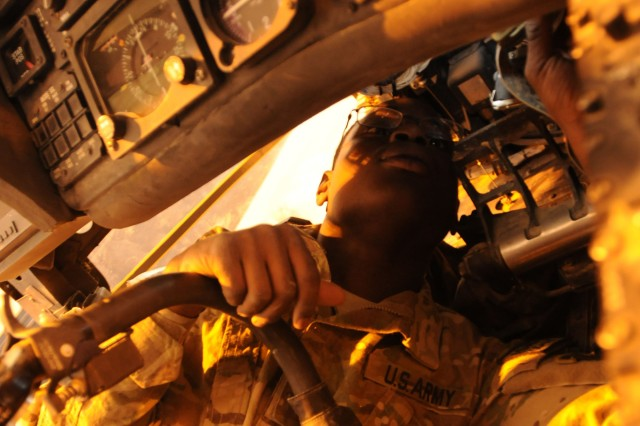 KANDAHAR AIRFIELD, Afghanistan (March 20, 2011) - Spc. Chad Hill, an aircraft electrician with Company B, 563rd Aviation Support Battalion, looks up the the order number for a replacement part on a UH-60A Blackhawk helicopter here March 20. Hill and the other Soldiers from the 159th Combat Aviation Brigade's avionic shop are essential to ensuring the Chinook and Blackhawk helicopters within the brigade are fit for missions throughout Regional Command South. (U.S. Army photo by Spc. Shanika L. Futrell, 159th Combat Aviation Brigade Public Affairs/ Released)