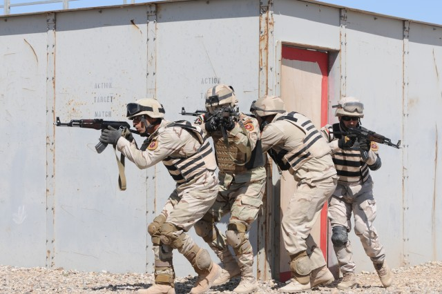 Iraqi soldiers stack along the outer perimeter of a building as they prepare to enter and clear the building on an Iraqi training site in Besmaya, Iraq, March 15. The soldiers participated in this exercise as a training observation for the Iraqi and U.S. command sergeants major from different divisions.