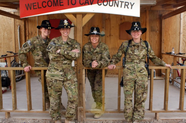 From left to right: Capt. Carmel Cammack, Capt. Donna J. Buono, Chief Warrant Officer 4 Anne Wiley, and Chief Warrant Officer 2 Elizabeth Kimbrough, all leaders within Task Force Palehorse, join for a group shot in outside the task force's operation center at Kandahar Airfield, Afghanistan.