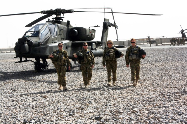 From left to right: Chief Warrant Officer 2 Elizabeth Kimbrough, Capt. Donna J. Buono, Chief Warrant Officer 4 Anne Wiley, and Capt. Carmel Cammack, all leaders within Task Force Palehorse, join for a group shot in front of an AH-64 Apache at their landing pads on Kandahar Airfield, Afghanistan. All four of the women fly either Apaches or OH-58D Kiowas. Wiley serves as the unit's senior standardization instructor pilot and is the first to hold that position at a squadron level.