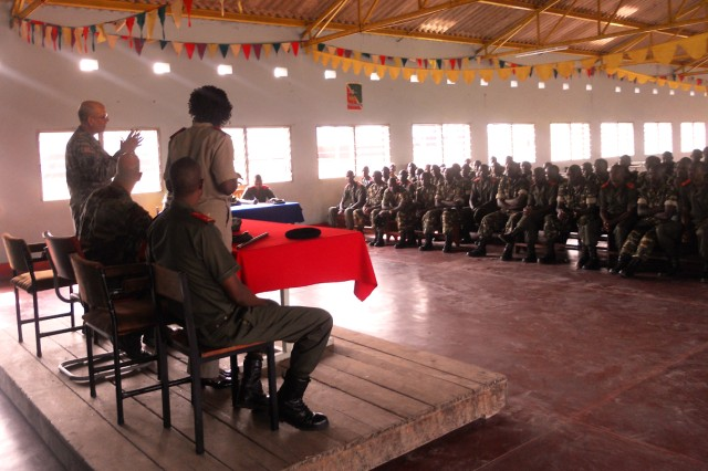 U.S. Army Africa Chaplain (Col.) Jonathan McGraw addresses 150 BFDN soldiers and their the base commander during a discussion of Combat and Operational Stress Control (COSC) at a paratrooper training camp.