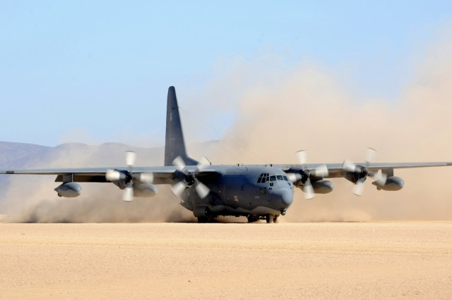 An HC-130P from the 81st Expeditionary Rescue Squadron taxis on a dry lakebed near Djibouti during a simulated rescue exercise Feb. 26, 2011.  The exercise scenario consisted of a Personnel Recovery Task Force of pararescuemen and an Army site security team responding to a downed aircrew, extracting two survivors, and returning them to safety.