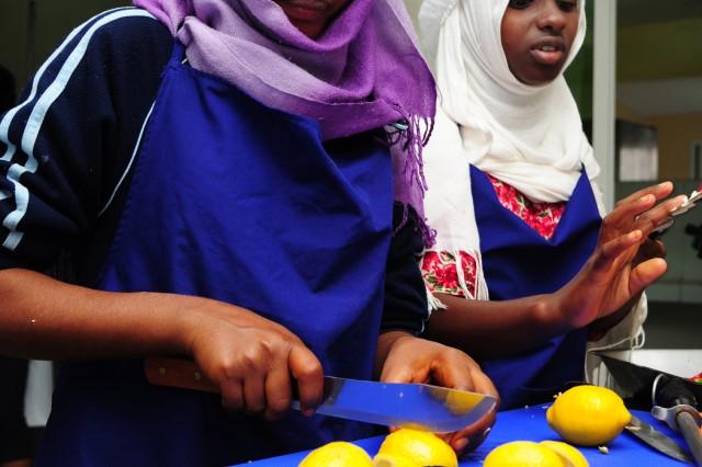 Arta Culinary School student Eissa Ahmed Gnnan cuts lemons during the culinary exchange in Arta, Djibouti, March 12, 2011.