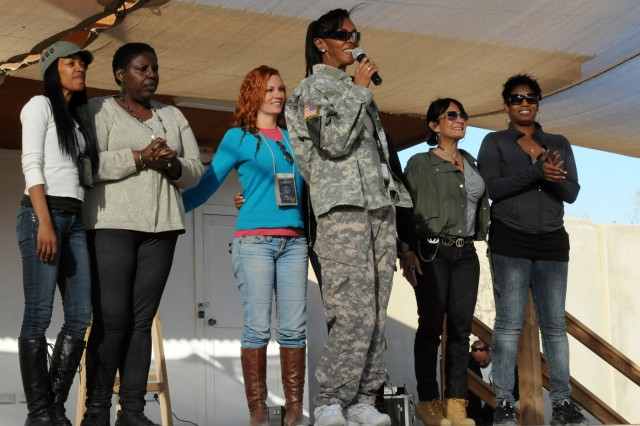 """BABIL, Iraq - Members of an all female comedy troupe take to the stage after their show on Contingency Operating Site Kalsu Monday. The ladies have traveled Kuwait and Iraq performing their """"Its Not That Time of the Month"""" tour. The show brings laughs to servicemembers and supports Women's History Month. US Army photo by Staff Sgt. Garrett Ralston (110314-A-8856R-160)"""