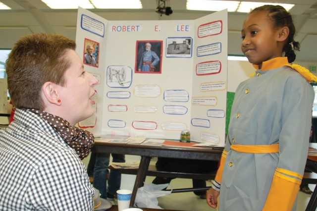 Parent Beata Hixson asks questions of Robert E. Lee, portrayed by Saniah Harris, 9, during the Robinson Barracks Elementary/Middle School Living History Museum March 11.