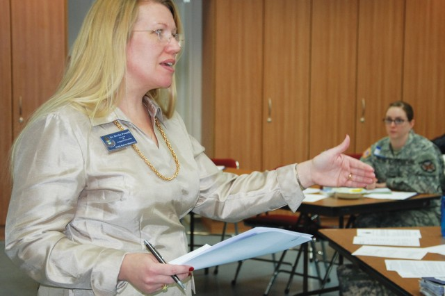 Dr. Becky Powell, director of religious education for the USAG Baden-Wuerttemberg Chaplain's Office, explains the importance of community support for military children during an in-service training for professionals working with military populations March 4 on Patch Barracks. The training was sponsored by the USAG Stuttgart Religious Support Office.