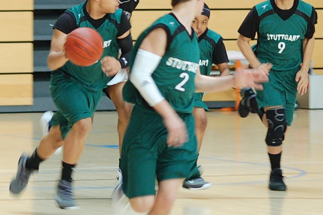 """Kingston Davis (from left) leads a fast break with teammates Jeffrey Kaczmarek, Chaz Young and Dominic Adams during the IMCOM-E Western Regional semifinal game against Mannheim March 13."""""""