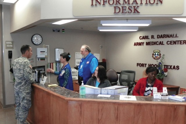 Red Cross volunteers Lynn Iwanski (second from left) and her husband, Ron, give directions to a visitor at the Carl R. Darnall Army Medical Center's information desk, March 11.