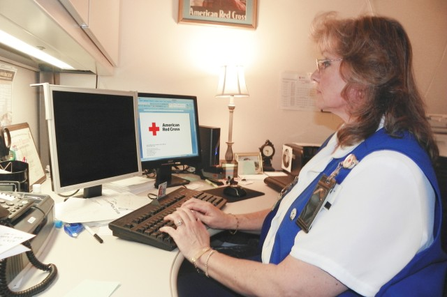 Debbie MacDonald, assistant station manager at the American Red Cross sub-station at Carl R. Darnall Army Medical Center, checks on the status of a Red Cross emergency message, March 11.