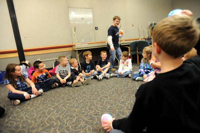 "Children play ""Duck, Duck, Goose"" while waiting at the Seattle-Tacoma International Airport USO, March 19, 2011."