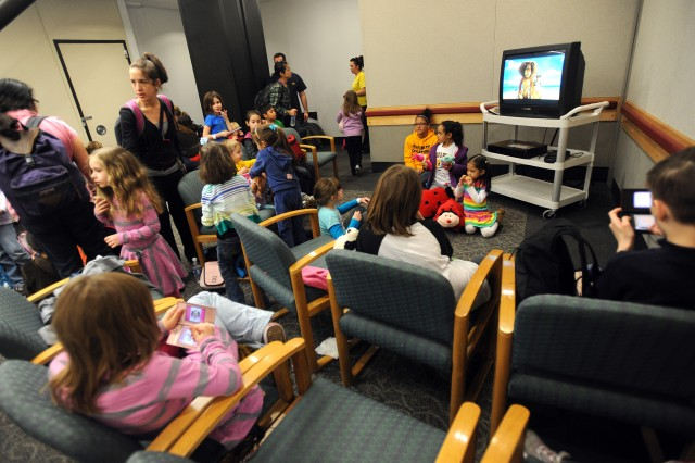 Children watch television at the Seattle-Tacoma International Airport USO, March 19, 2011.