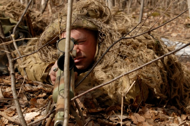 Oriskany, N.Y. -- Spc. Mark Dorsey, a sniper team leader with 2nd Battalion, 108th Infantry, scans an area during an exercise at the New York State Preparedness Training Center here March 18.