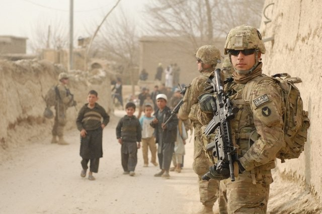 Spc. Carlos R. Hansen and fellow Soldiers of the personal security detachment for Headquarters and Headquarters Troop, 1st Squadron, 113th Cavalry Regiment, Task Force Redhorse, patrol the villages in the Bagram Security Zone.