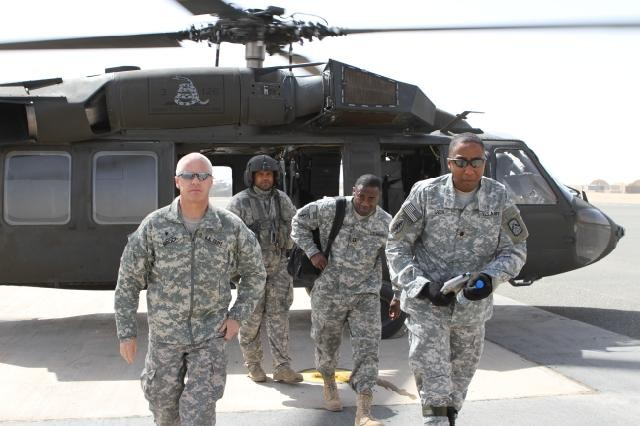 Brig. Gen. Lawrence W. Brock III, Commanding General of 335th Signal Command, and Lt. Col. Duane Green, Commander, 54th Signal Battalion, step off a Blackhawk helicopter at Udairi Army Airfield, Camp Buehring, Kuwait. Brock toured 581st Signal Company's Technical Control Facility. (U.S. Army photo by Christopher Dunne, 160th Signal Brigade Public Affairs.)