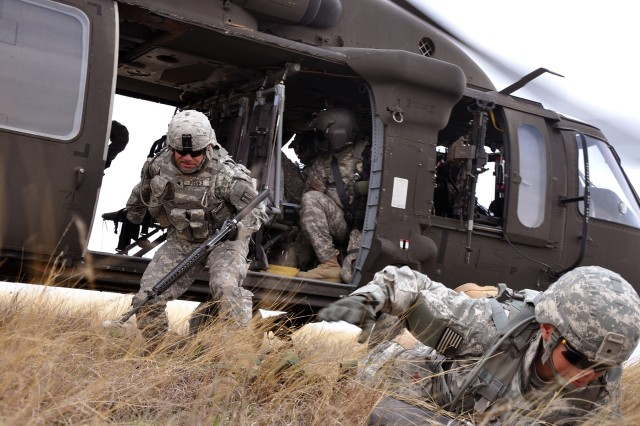 FORT HOOD, Texas-Spc. Alexander Perez (left) and Spc. Cherish Truong,  both radar operators with Battery A, 26th Field Artillery Regiment, (Target Acquisition Battery), 41st Fires Brigade, jumps out of a UH-60 Black Hawk helicopter to pull security during Operation Wild Horses II on North Fort Hood, Texas, March 17.