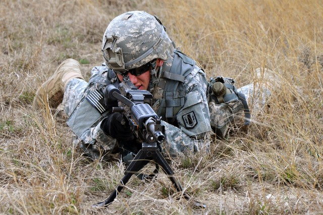 FORT HOOD, Texas-Spc. Jonathan Almeida, from Miami, a radar operator with Battery A, 26th Field Artillery Regiment, (Target Acquisition Battery), 41st Fires Brigade, pulls security during Operation Wild Horses II on North Fort Hood, Texas, March 17.
