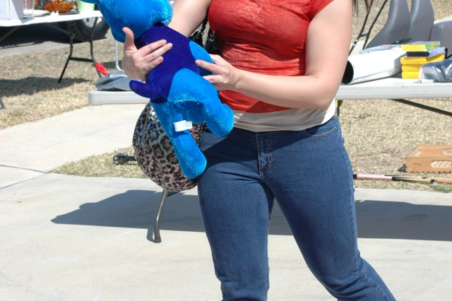 "COPPERAS COVE, Texas-Marlena Hanna looks through a row of toys during the ""Boobie Brigade"" breast cancer awareness yard sale fundraiser in Copperas Cove, Texas, March 18-19."
