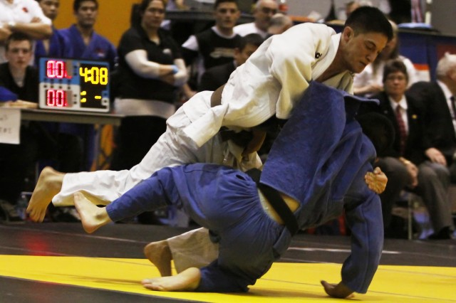 West Point Class of 2011 Cadet Joshua Sandhaus (in white) defeated all competitiors to place first in the Advanced Men's 66kg division March 12 at the 50th National Collegiate Judo Association's Championship tournament at Arvin Cadet Physical Development Center.