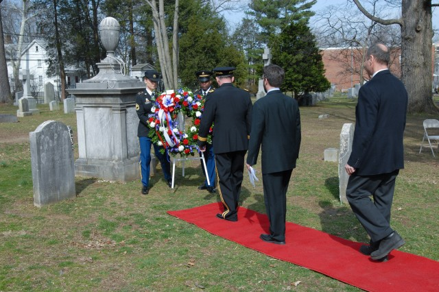 Maj. Gen. William D. Razz Waff, commanding general, 99th Regional Support Command (left), Chad Goerner, mayor of Princeton Township (center), and Councilman Kevin Wilkes, representing Mildred Trotman, mayor of Princeton Borough (right), proceed to the Presidential Wreath during a special memorial service that honored President Grover Cleveland's 174th birthday.