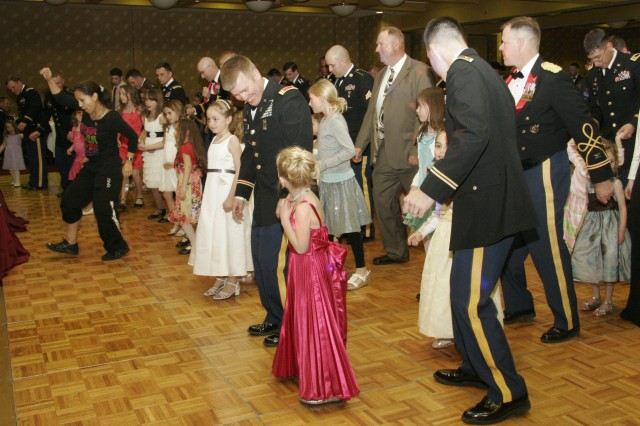 FORT CARSON, Colo. -- Servicemembers and their daughters enjoy a lesson in line dancing from  a Zumba instructor, during the Father-Daughter Dance at the Crowne Plaza Hotel banquet hall.