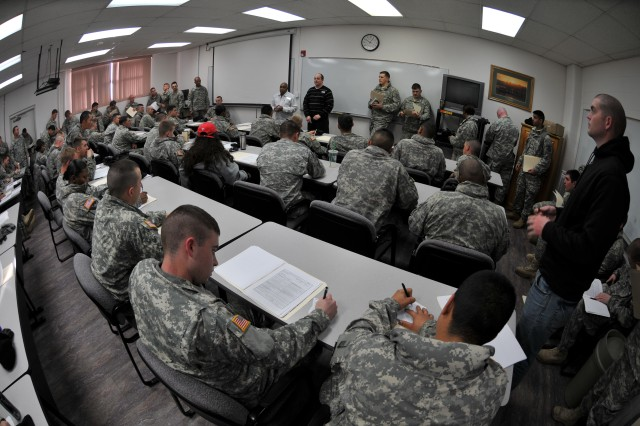 FORT WAINWRIGHT, Alaska -- Soldiers attend a briefing by Jeffrie Clarke, traffic manager and Jeffery Johnson, transportation technician, March 23. Soldiers from the 1st Stryker Brigade Combat Team, 25th Infantry Division learned how to prepare and submit paperwork for the storage of their personal property and vehicles while they are deployed. Transportation office staff assist Soldiers to ensure they have all the necessary documentation and also that they understand how to prepare their vehicles for long-term storage. Vehicles of single Soldiers are stored at government expense in a climate controlled storage facility while they're deployed. The winter season is lengthy in Interior Alaska and temperatures dip to 40-below zero and colder in the Fairbanks area.