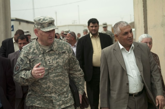 Maj. Gen. Jerry Cannon, deputy commanding general for detention operations and provost marshal general, United States Forces - Iraq, meets with Iraqi staff Maj. Gen. Jawad Kadhem, deputy director, Iraqi Correction Service, as Cannon prepares to turnover 100 vehicles to the ICS, March 12, in Taji, Iraq.