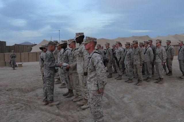 FORWARD OPERATING BASE EDINBURGH, Afghanistan (Mar. 21, 2011) Lt. Col. Charles R. Bowery, Jr., the commander of 1st Attack Reconnaissance Battalion, 4th Combat Aviation Brigade, presents Army Achievement medals to Marines during a ceremony here Mar. 20. Ten Marines received the awards for helping Bowery's Task Force Dragon complete its special operations missions by offering exceptional efficiency in refueling aircraft.