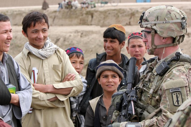 First Lt. Landon Fisher, 1st Platoon Leader, A Company, 2-18 Infantry, 170th IBCT, meets with locals of the Nawbot village located north of the Dananeh-i Ghowri region.