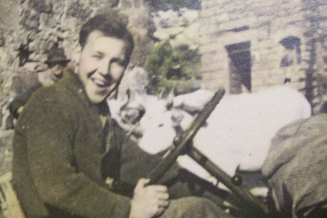This undated photo shows Pvt. Henry Schuessler at the wheel of a jeep in Italy during World War II.