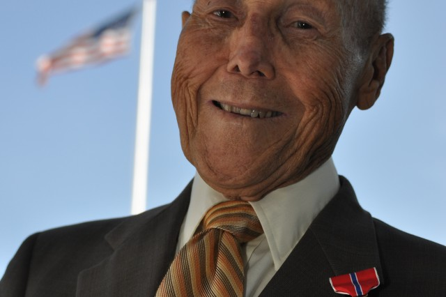 Henry Schuessler, 86, displays his newly-awarded Bronze Star in front of Post Headquarters, Monday. Schuessler received the award 67 years after he helped rescue a wounded Soldier from a mine field in Italy during World War II.