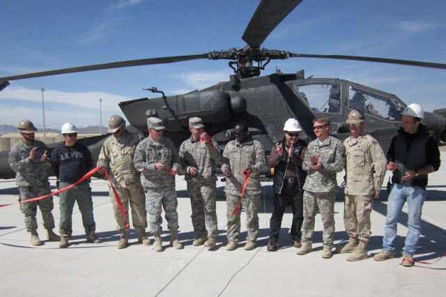 Key personnel from the Forward Arming and Refuelling Point expansion project at Forward Operating Base Shank, Afghanistan, join in the ribbon-cutting ceremony before the first aircraft, an AH-64 Apache helicopter, took on fuel from the new FARP on March 10.