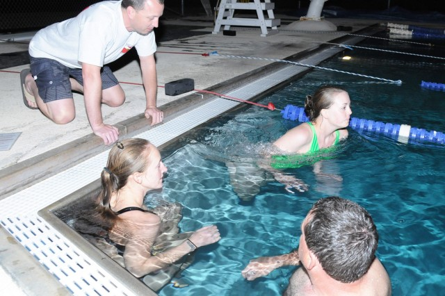 Lindsey Reich, Fort Rucker Aquarian club member, pushes off to begin her underwater swim.